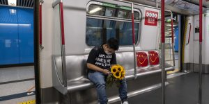 Hong Kong's famed subway reeling from protests, virus Outbreak